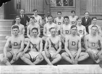 Track Team 1924. Top Row: D.L. Holmes (Coach), Vincent, Griffiths, Snyder, Platz, O'Neil (Manager). Middle Row: Leacock, Doherty, Zuber, Gentile, Armstrong, Pascoe. Bottom Row: Brown, Paul, Seitz (Captain), Blanchard, Cooper.