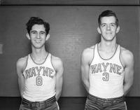 Two basketballers, Nos. 8 and 3, pose for a portrait.