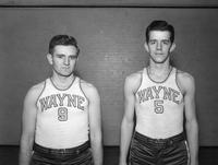 Two basketballers, Nos. 9 and 5 (VanVleck), pose for a portrait.