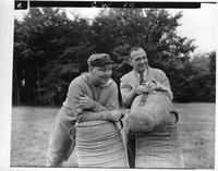 A Coach and Mayor Jeffries rest on the heavy bags.