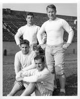 Four University of Akron players. Sitting Paul Baldacce. Kneeling Andy M_, Left sitting: Ben Flossia. Right: Otis Douglas.