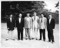 The 1955 golf team in formal attire.