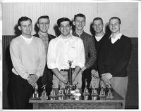 Volleyball. Six men stand in front of a cache of trophies. Ed Berson, Bill Tituskin, Joe Epstein, John Radwanski, Paul Buechler, Ernie Buechler.