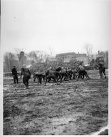 A football play in action, circa 1920s or 1930s.