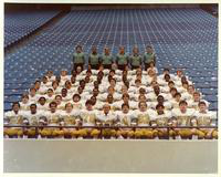 A portrait of the 1981 Football team in the stadium stands.