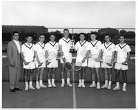 The 1956 tennis team hoists a trophy.