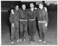 Four track team members in an informal shot.
