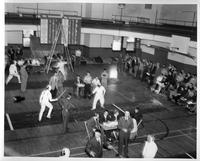 A 1957 fencing meet in the gymnasium.