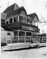 The rowing team's crew house, presumably on Belle Isle, with the trailer for the boat parked out front.