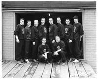 The 1958 rowing team/crew pose for a picture.
