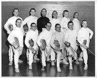 The 1958 fencing team poses for a portrait.