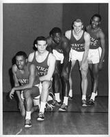 Five players from the 1959-1960 basketball team. Campbell, Sbuka (sp?), Mozley, Holmes, Allen.