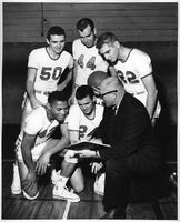 A shot of five basketball players with the coach. #44 Walt Koepke, #50 Gunars Vitolins, #42 Winfield Henry, #24 Bob Wright, #22 Larry Cook, Coach Joel Mason.