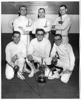 Six members of the fencing team pose with a trophy. The 1958-1959 Presidents' Athletic Conference Champions.
