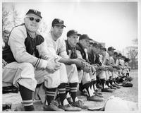 A shot of the 1959 baseball team on the bench.