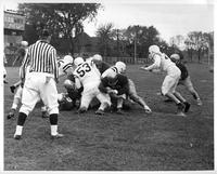 A football play in action at Tartar Field.