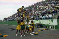 1992 football action shot versus Ferris State University (Cheerleaders and the stands).