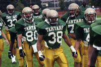 1992 football action shot versus Ferris State University (Team takes the field).
