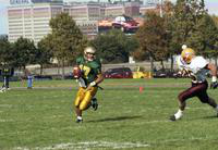1994 football action shot versus Ferris State University The General Motors Building is in the background.