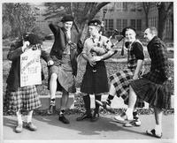 Men in Kilts gather to play the bagpipes.