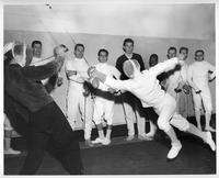 Two fencers sparring in the 1960-1961 season.