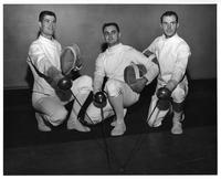 Three fencers.