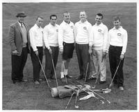 The six-member 1960 golf team pose for a portrait with the coach.