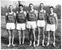 Five members of the 1960 track squad pose for a portrait.