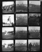 Proof sheet of twelve 2x2 negatives of the 1961 Homecoming game. Scoreboard, football, floats, marching band.