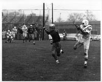 Bill Kickel, John Carroll halfback, waits for a pass that never came. Wayne State's halfback Bill Koury knocked it down. Byt [sic] it didn't stop John Carroll, who piled up 67 points to Wayne State's 14 at Tartar Field.