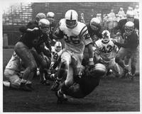 SCOUT DOWN! And seven members of the Tartar posse to go . . . Out in front of the back is John Carroll halfback Tim Allen (25), who scored four plays later in his team's 67-14 win over Wayne State at Detroit on Oct. 13, 1962.