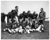 Northwest Detroit gridders on the Wayne State football team are (L-R) top: Guard Jim Moore, quarterback Don Smith, fullback Dempsey Harrison, tackle Arnold Harris, end Bob Swallow, and Wayne State Head Football Coach Hal Willard. Bottom: Guard Mike Weisenfeld, halfback Brian Hitsky, end Andy Jackson, and fullback Jim Morgan.