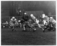 Wayne State halfback John Kocher puts his head down and bulls his way to an eight-yard gain against John Carroll of Cleveland, 0. [sic] at Tartar Field, October 13, 1962.