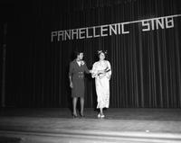 An award is presented on the PanHellenic Singers' stage.