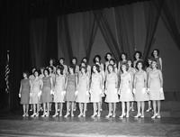 The PanHellenic Singers perform a number with white gloves for formality.