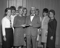 Clarence Hilberry shares a moment with a women's group.