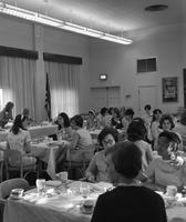 Students eat lunch at a women's banquet.