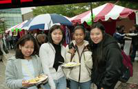 Four students with food at the International Fair.