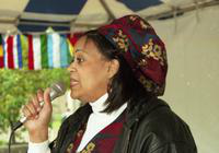 A woman makes a speech at the International Fair.