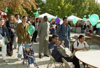 President Irvin Reid and others watch an event at the International Fair