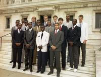 1984 basketball team portrait in suits in front of the Detroit Public Library.