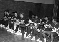 The 1985 basketball team on the bench versus Ferris State.