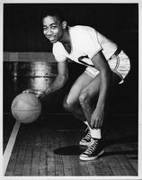 A portrait of Hutchin (sp?) in action 1953 basketball.