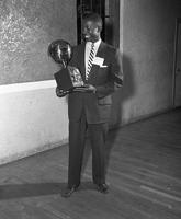 Clarence Straughn holds his MVP trophy in 1955.