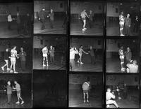 Proof sheet of shots showing President Keast awarding the 1967 basketball team with trophies.