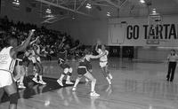 Action shot 1986 men's and women's basketball game. Men's game.