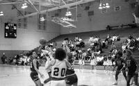1990 women's basketball action shot. Versus Saginaw Valley State University