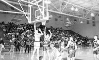 1992 basketball action shot versus Hillsdale.