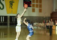 1992 women's basketball action shot versus Hillsdale.