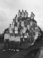 1986-1987 basketball team portrait on a train.